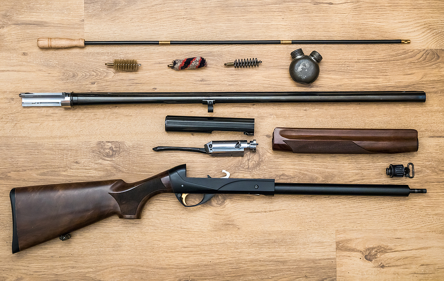 Disassembled Firearm & Tools for Firearm Maintenance